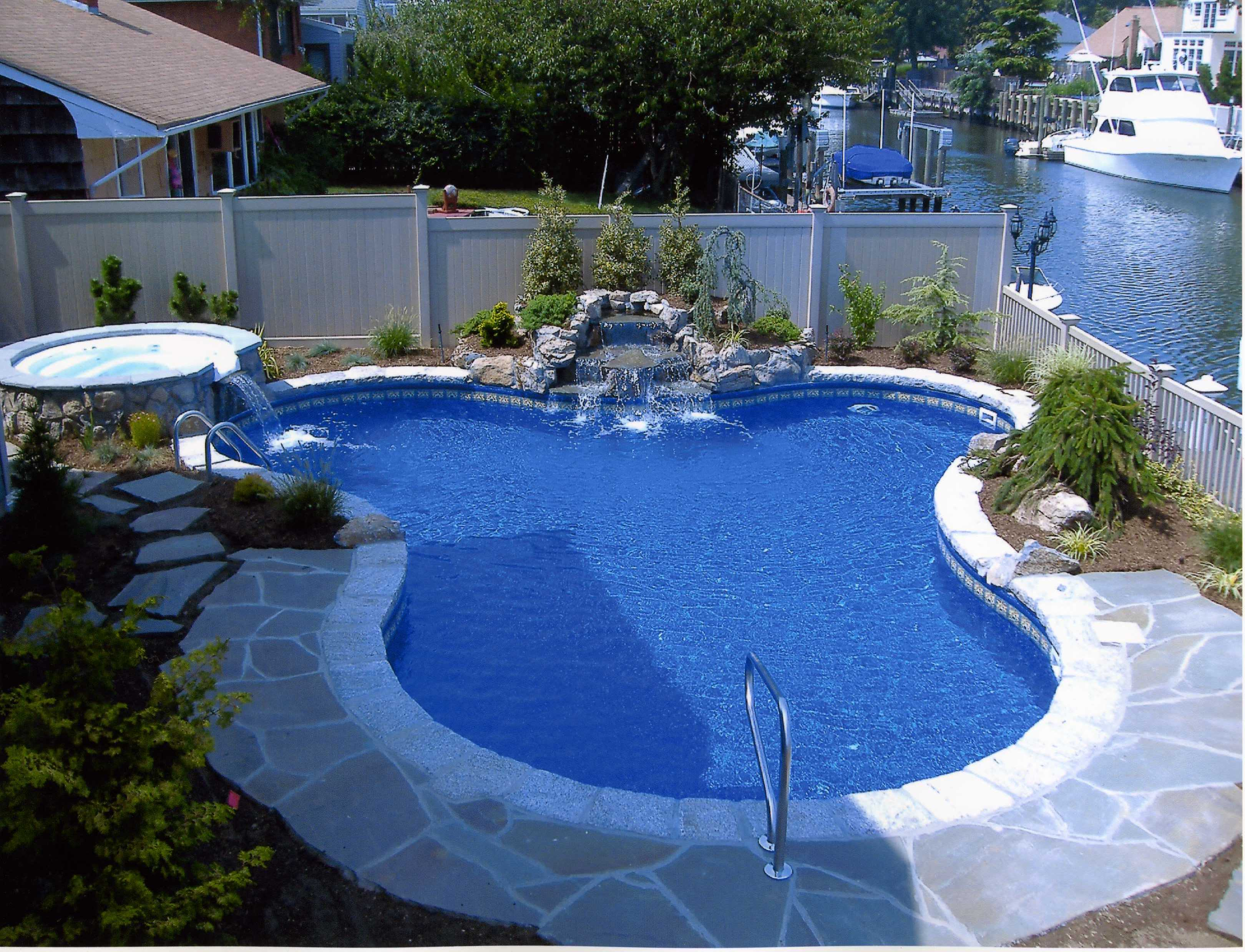Backyard landscaping ideas swimming pool design for Swimming pool patio designs