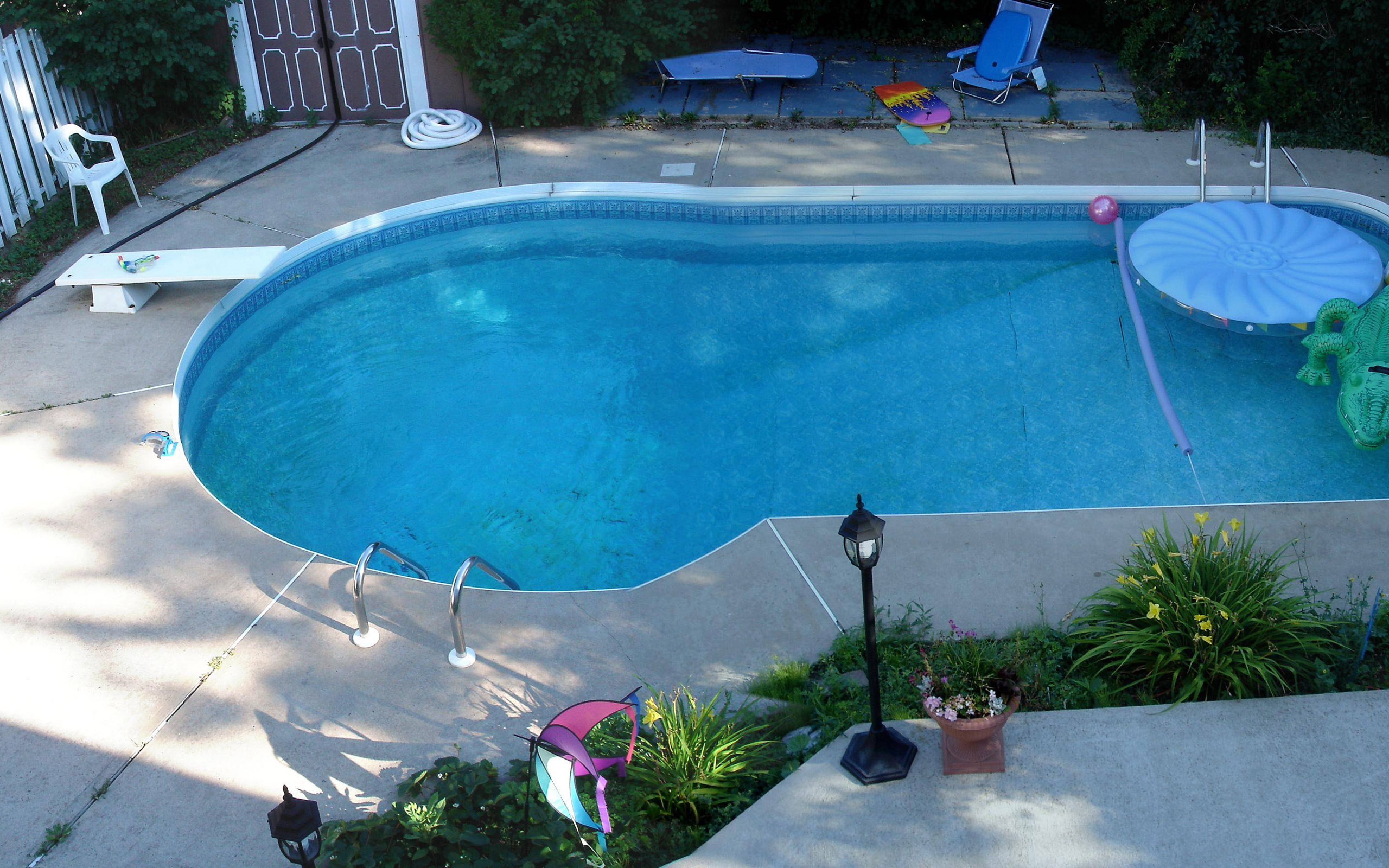 Backyard landscaping ideas swimming pool design for Swimming pool surrounds design