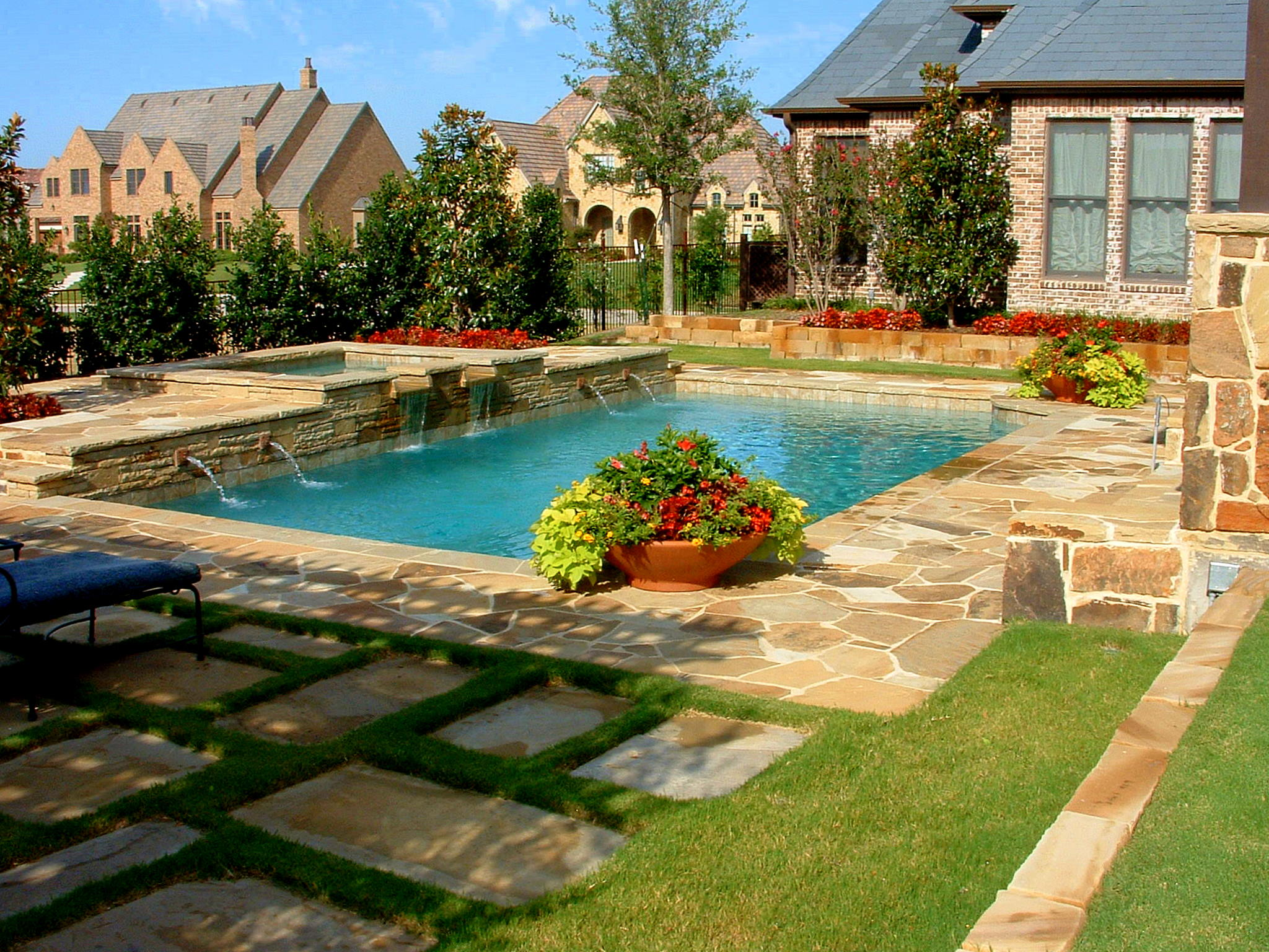 Backyard landscaping ideas swimming pool design for Pool design sloped yard