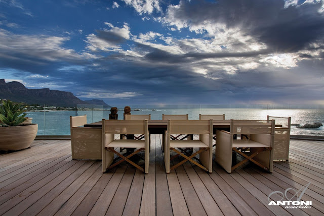 Clifton View Mansion By Antoni Associates Overlooking Cape Town – South Africa: Contemporary Display of Luxurious Interior Design ocean view dinning place on wooden deck