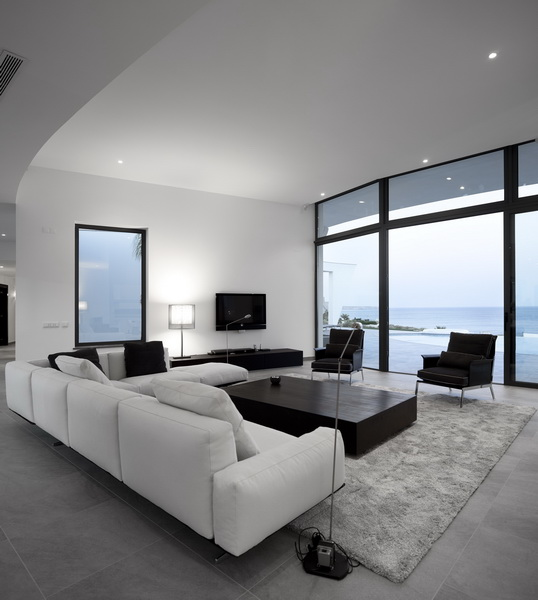 white and black living room design in Colunata House by Mario Martins in Lagos, Algarve, Portugal, Great Example of a Modern Mansion (4)