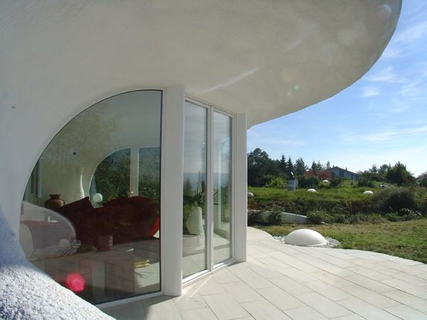 Earth House Estate Lättenstrasse in Dietikon, Switzerland by Vetsch Architektur Homesthetics curved roof