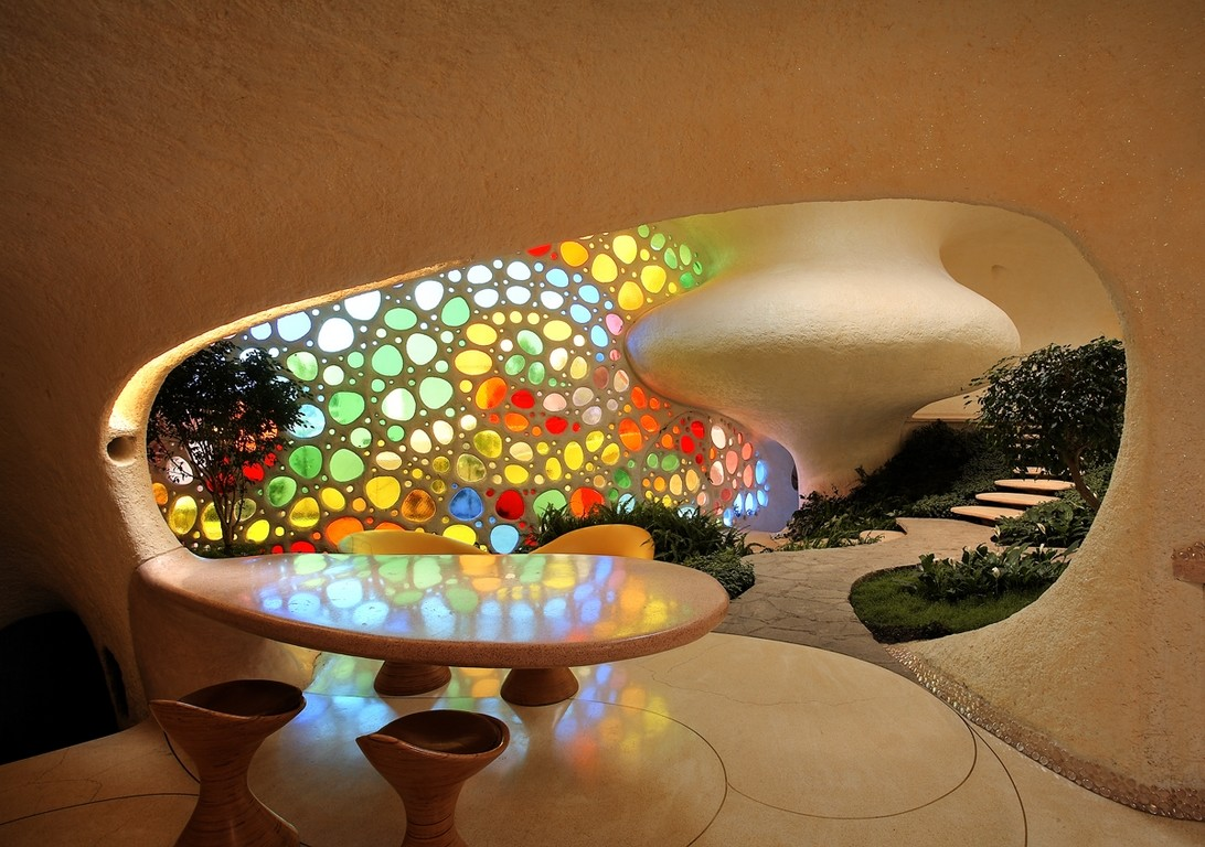 small dinning area and colorful glass windows  Higly Organic Fluid and Colorful Mansion in Mexic-Nautilus by Javier Senosiain