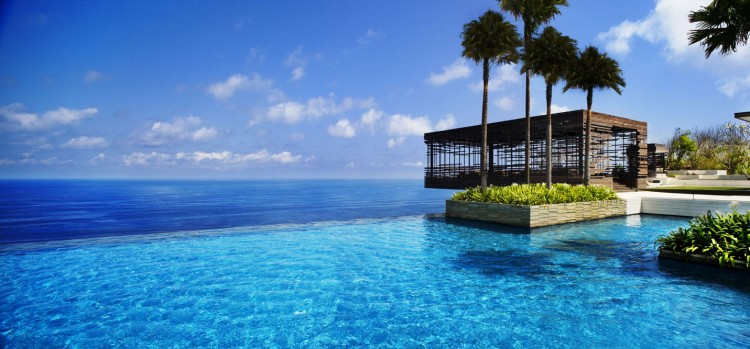 Luxurious Interior Design Hosted in Heaven- Alila Villas Uluwatu by WOHA Architects view of the pation with incredible infinity pool relaxation zone luxury decadence inifnite