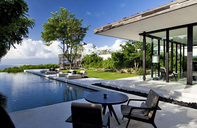 Luxurious Interior Design Hosted in Heaven- Alila Villas Uluwatu by WOHA Architects view of the pation with incredible infinity pool relaxation zone luxury decadence