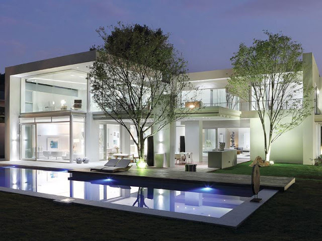 Paradise Found Hyde Park- Luxurious Contemporary Mansion by Summersun Property Group incredible lighting system nightime contemporary modern dream home