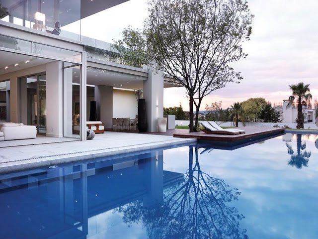 Paradise Found Hyde Park- Luxurious Contemporary Mansion by Summersun Property Group inifinity pool contemporary design sophisticated materials wealth