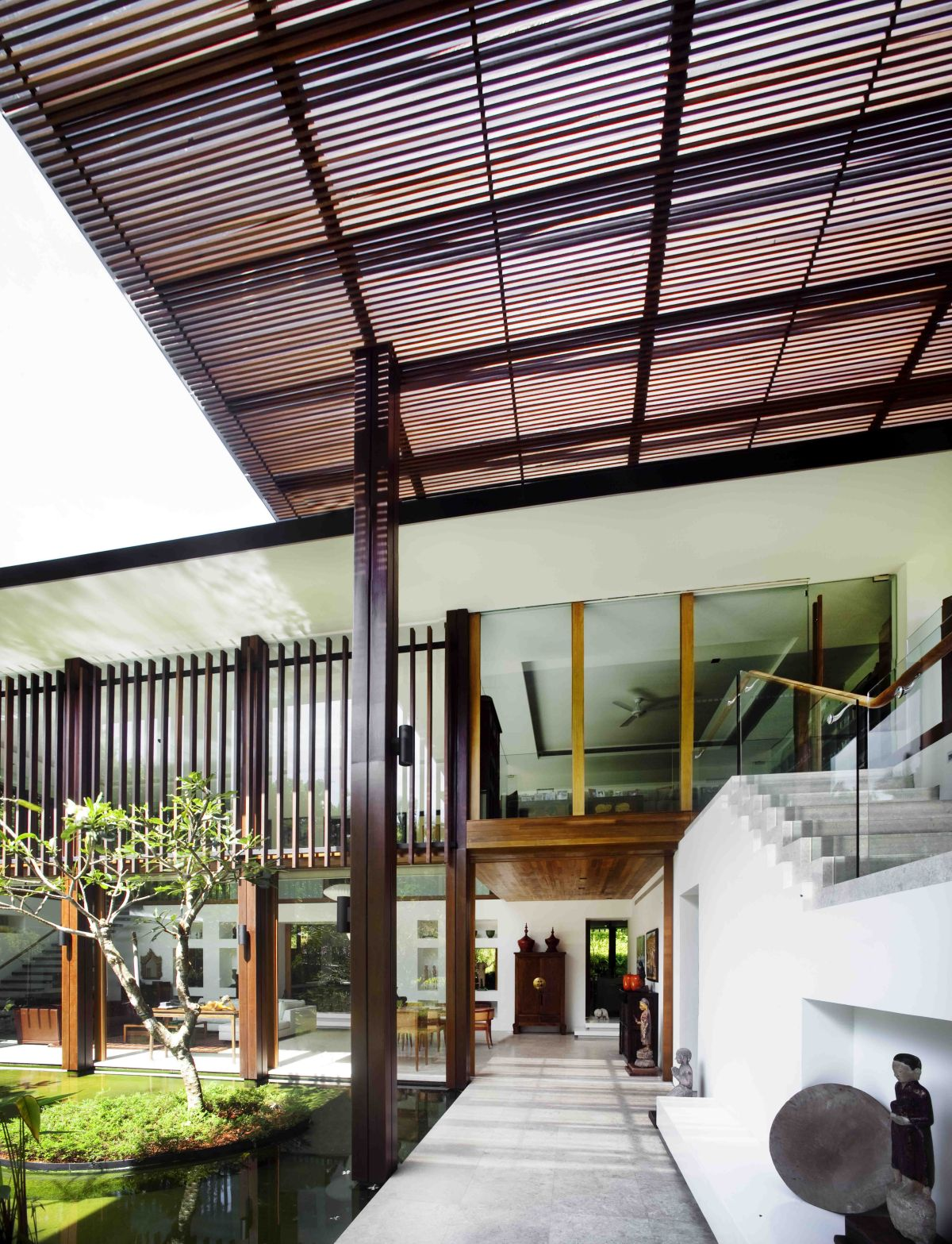 The Sun House by Guz Architects: A Hevean of Green in Singapore Displayed in a Modern Mansion contemporary interiro design warm materials