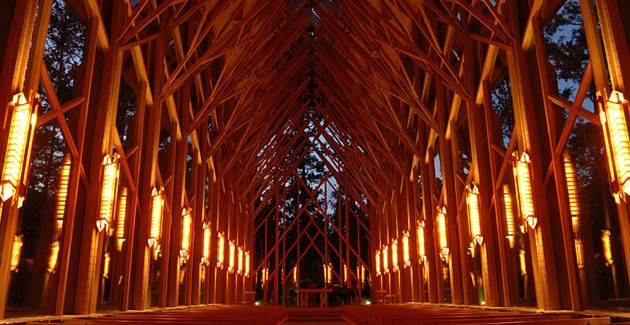 Thorncrown Chapel by E. Fay Jones perfect ilumination unusual shape and size perfect integration modern concept design visitors in the middle of the forest interior lighting religious atmosphere