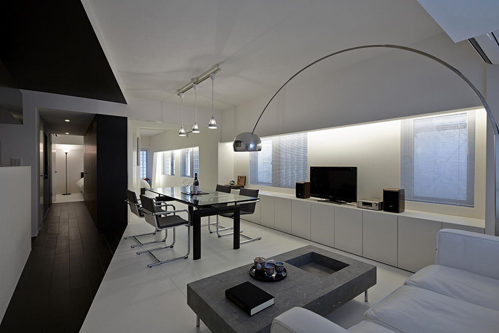 black and white apartment design in tokyo contemporary interior design minimalsit space clean lines edgy contemporary design clena space design elegant finishes black accent wall in the evening