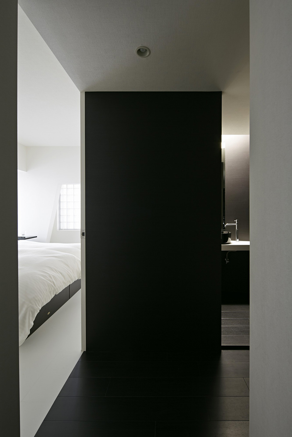 black and white apartment design in tokyo contemporary interior design minimalsit space clean lines edgy contemporary design clena space design  elegant finishes black accent wall