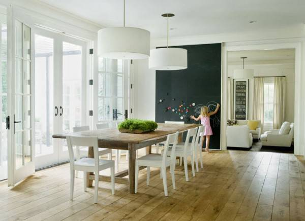 black wall used as an accent to deocrate the clean minimalsit dinning space