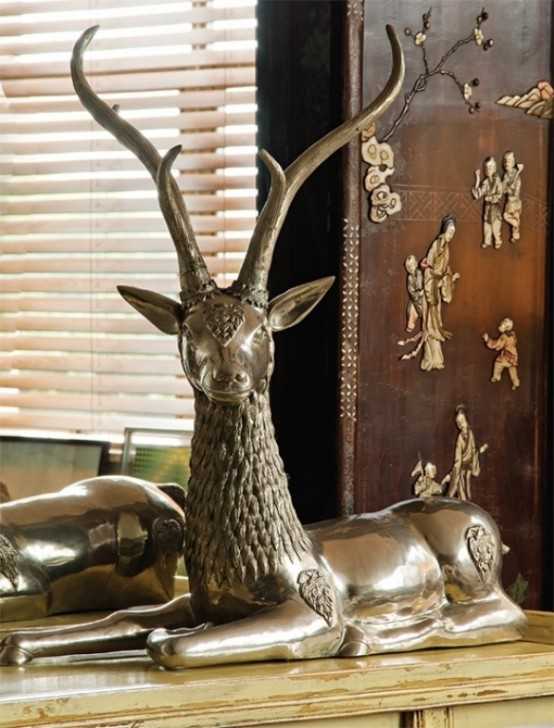 amazing bronze deer sculpture in colorful-unusual-apartment-in-a-mix-of-styles-1-554x728