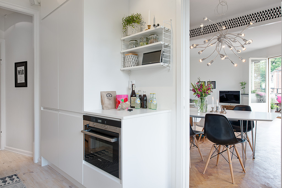 white and black kitchen area and black dining roomcontemporary interior sweedish design featureing scandinavian playful and cheerful assets homesthetics black and white design (1)