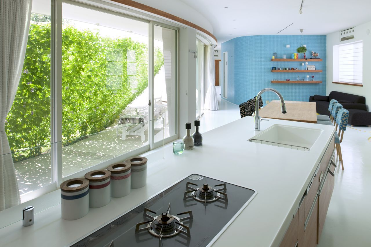 view from the kitchen to the green wall Fluid Organic & Sustainable Assets Featured In a Japanese Home by Hideo Kumaki Architect Office