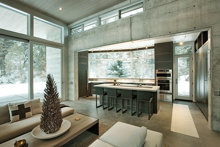 black and white dinning room and white living room design Unusual Winter Retreat Featuring Exposed Concrete and Huge Windows near Aspen, Colorado