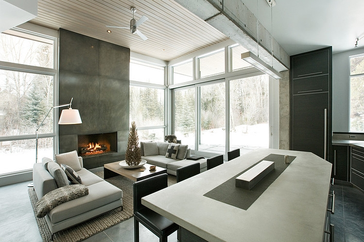 exposed concrete black and white living room interior design Unusual Winter Retreat Featuring Exposed Concrete and Huge Windows near Aspen, Colorado