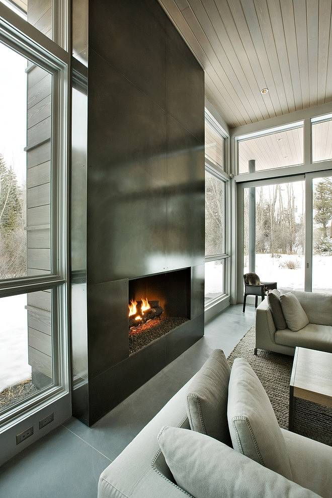living room black and white design modern mansion Unusual Winter Retreat Featuring Exposed Concrete and Huge Windows near Aspen, Colorado