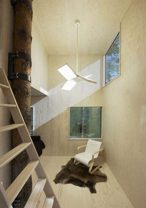 Homesthetics Conclusion:  The level of transparency and reflectiveness allows this particular design to perfectly integrate into the chosen environment.By mimesis it becomes one with the canopy of trees, offering its guests an unique natural experience. Photo courtesy to Tham & Videgård Arkitekter interior modern design minimalsit design shape furniture
