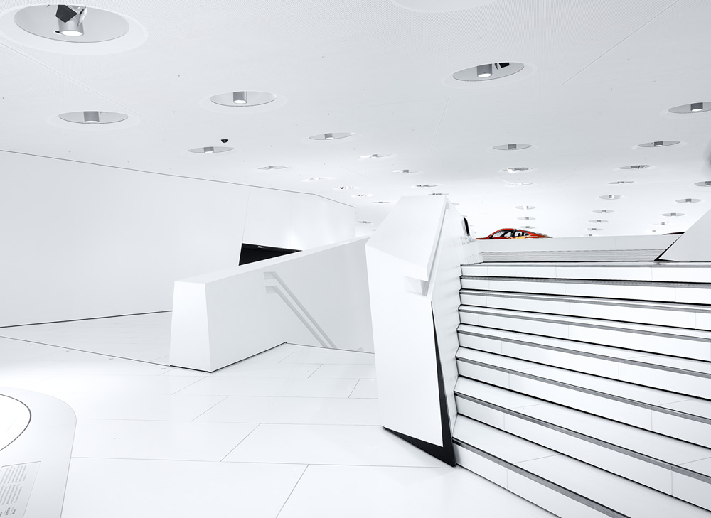 Porsche Museum in Stuttgart – Germany designed by Delugan Meissl contemporary display of modern design white finishes touches accents