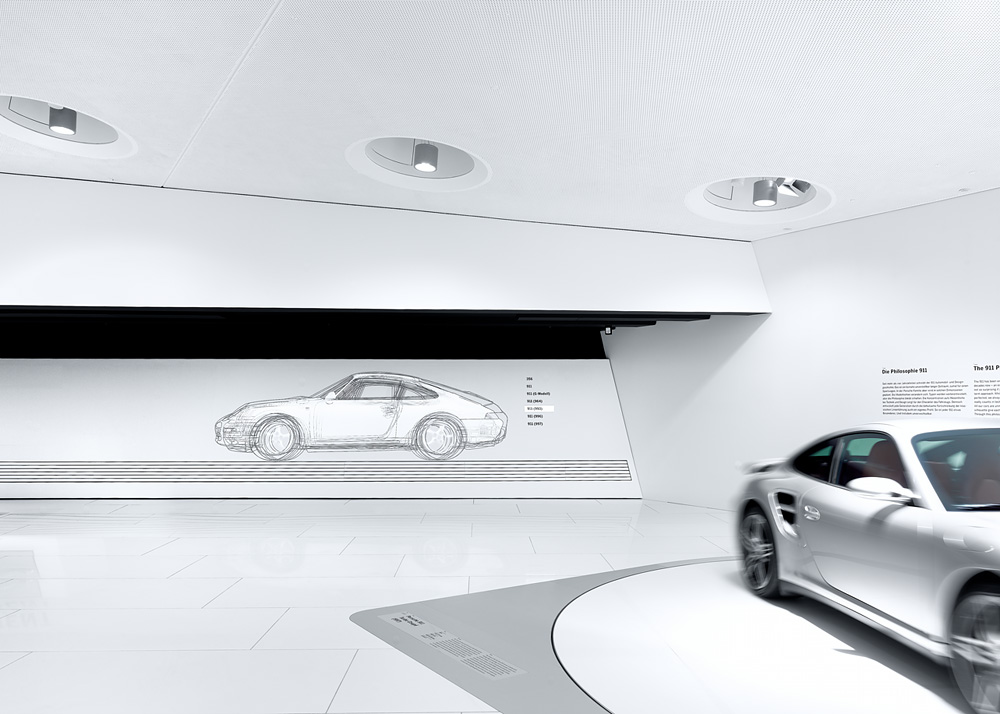 Porsche Museum in Stuttgart – Germany designed by Delugan Meissl contemporary display of modern design white finishes rendering