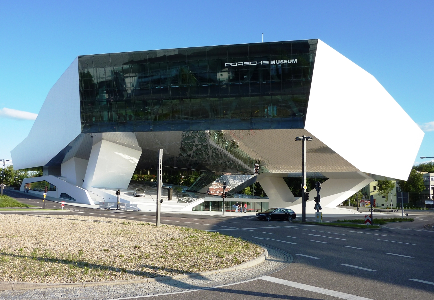 Porsche Museum in Stuttgart – Germany designed by Delugan Meissl contemporary display of modern design white finishe modern elegance contemporary approach oitdoor facade