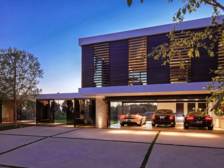 high end luxurious garage area in the 1201 Laurel Way-Cliff View Luxurious Modern Mansion in Beverly Hills California