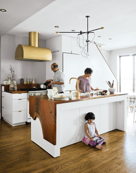 white stak kitchen interior design featuring a place under the counter for various functionalities
