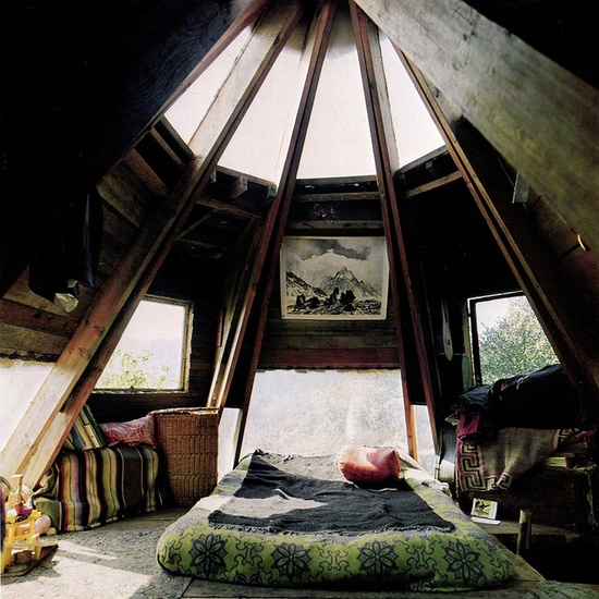 ten realized out of wood with skylight and extraordinary lightning transformed in a bed