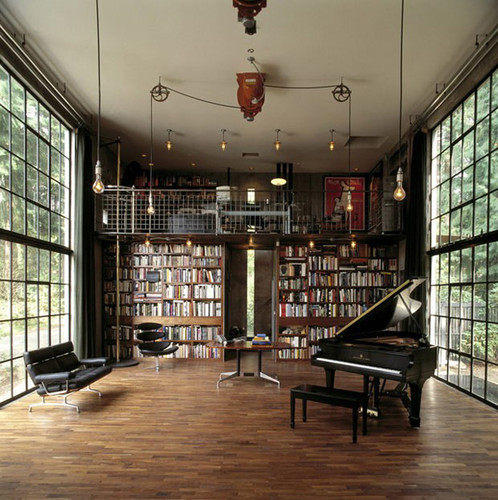 amazing library with peanu and huge windows on both sides