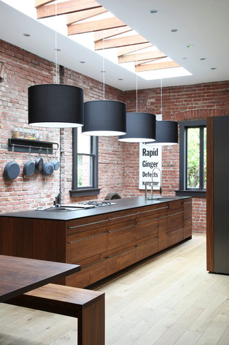 brick kitchen with wooden counter and raw unfinished touch