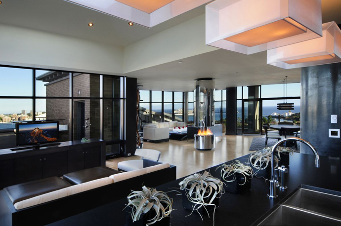 black and white living room with fireplace Austonishing Penthouse Apartment with 360-degree Views Over Victoria, Canada modern mansion (23)
