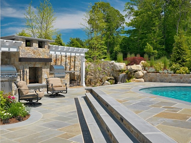 brick fireplace by the swimming pool Backyard-Lanscaping-Ideas-Fireplaces-homesthetics