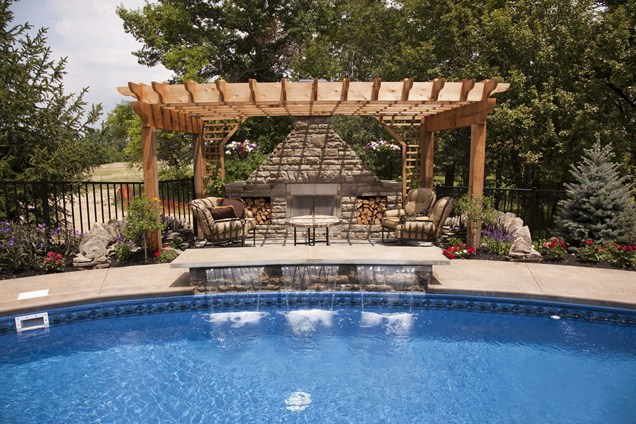 fireplace by the swimming pool Backyard-Lanscaping-Ideas-Fireplaces-homesthetics