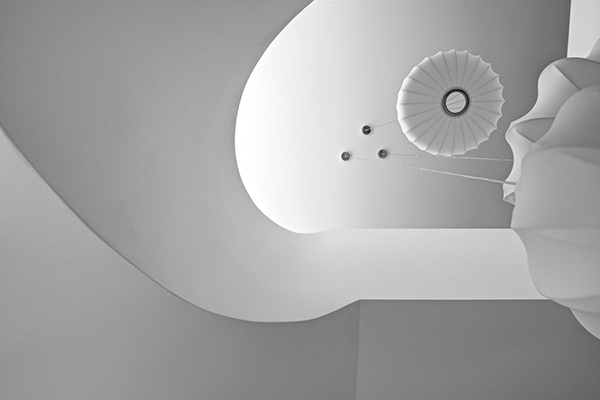 stark white sculptural staircase design expressed in a modern mansion