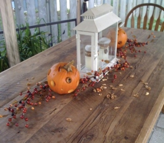 white latern on the patio DIY -Welcome the Fall with Warm and Cozy Patio Decorating Ideas homesthetics (41)