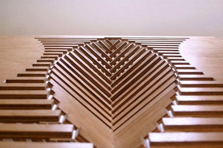 zoom in the opening of the Experimental Furniture-Kirigami Inspired Rising Table designed by Robert van Embricqs (1)