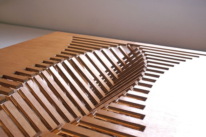 detail shot Experimental Furniture-Kirigami Inspired Rising Table designed by Robert van Embricqs (1)