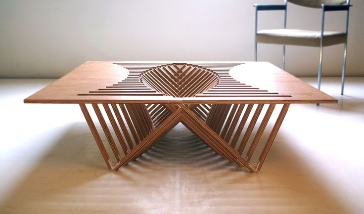 perspective view Experimental Furniture-Kirigami Inspired Rising Table designed by Robert van Embricqs (1)