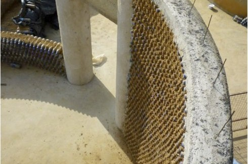 detail shot of the walls of Experimental Living- Sustainable Plastic Bottle House by D.A.R.E (1)