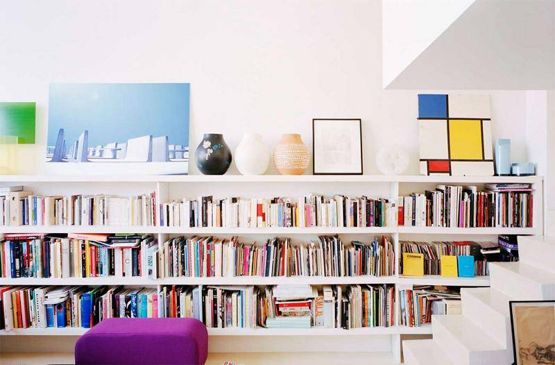 colorful bookcase in Modern Innovative Valentin Apartment by Emmanuel Combarel Dominique Marrec