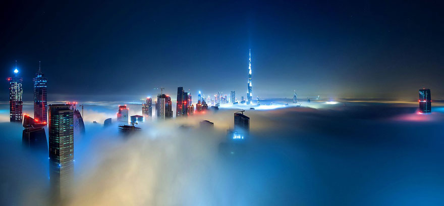 burj khalifa at nigh A City in the Clouds – Dramatic Photos of Skyscrapers Piercing the Fog Above Dubai