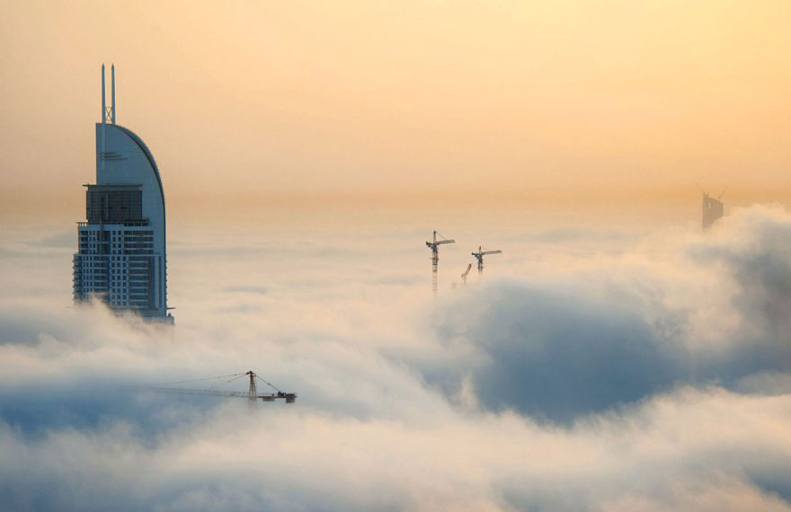 A City in the Clouds – Dramatic Photos of Skyscrapers Piercing the Fog Above Dubai