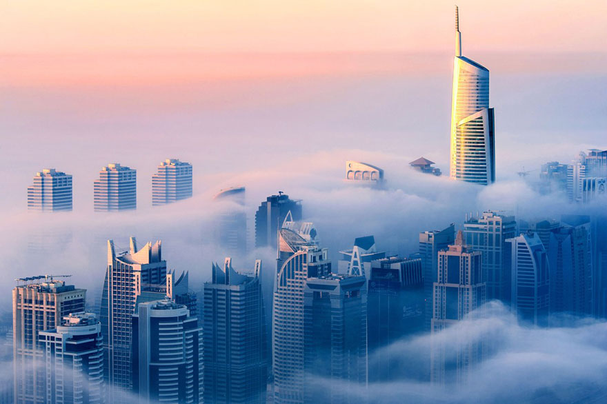 fog A City in the Clouds – Dramatic Photos of Skyscrapers Piercing the Fog Above Dubai