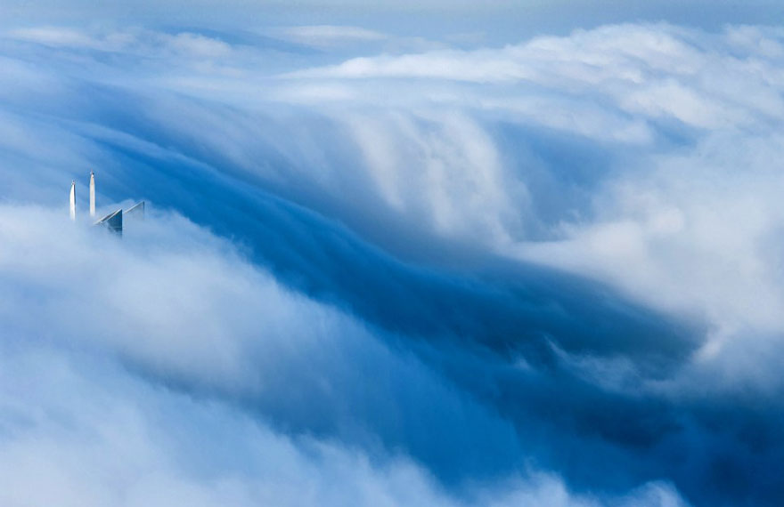 just fog A City in the Clouds – Dramatic Photos of Skyscrapers Piercing the Fog Above Dubai