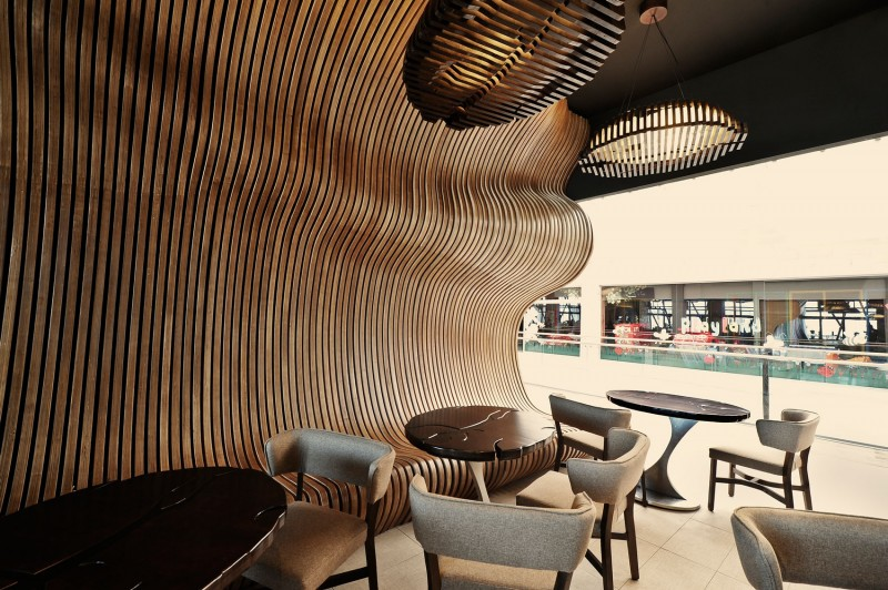 curved walls materialized using laser in a doncafe showroom