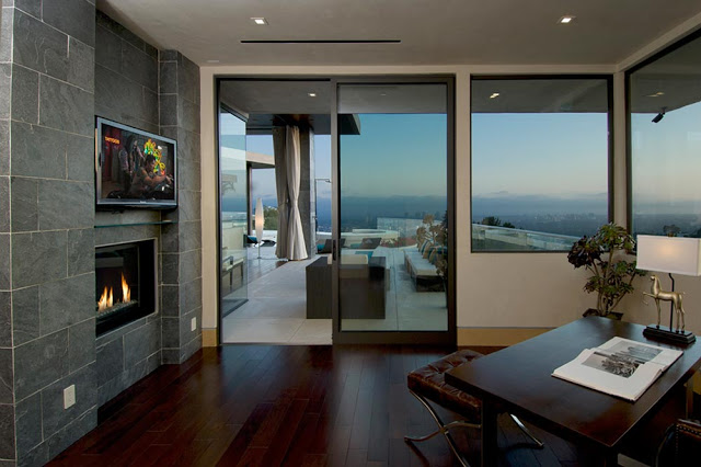 modern fireplace in the blue jay way street Extraordinary Cliff View Modern Mansion Located on the Sunset Boulevard in Hollywood Hills homesthetics (2)