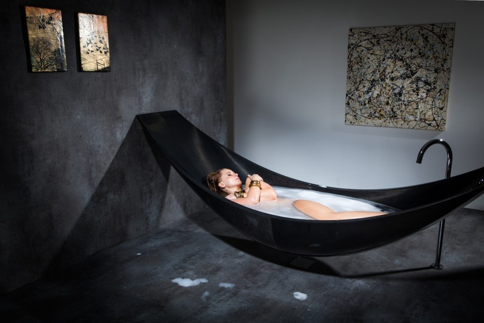 lady having a bath modern black hammock-bathtub-design-made-from-layers-of-carbon-fiber-by-Splinter-Works-sleek-bath-tub-floating-bath-tub-Homesthetics-1 (20)
