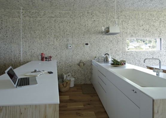small stark white open kitchen unique-house-reminding-of-a-hare-form-13-554x395