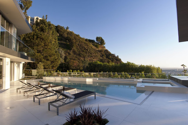 infinity swimming pool and expansive views 1734 Doheny - Cliff View Modern Home In Hollywood Hills, California by Luca Colombo